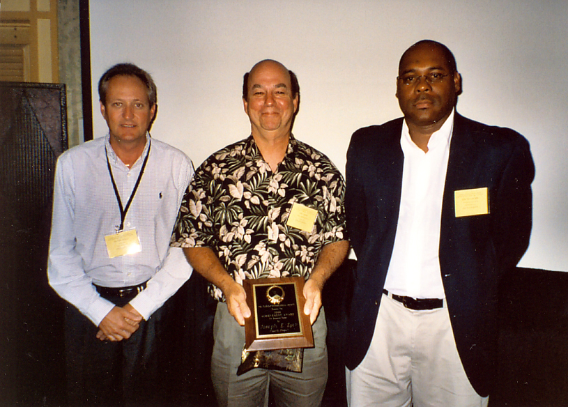 2008 Team Research award presented by Oscar Liburd to David Hall (left) and Joe Eger (center)