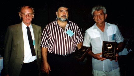 Ara Manukian and Rudy Strohschein, two of the three recipients of the Annual Achievement Award to Industry and Team Research (combined), with Howard Frank