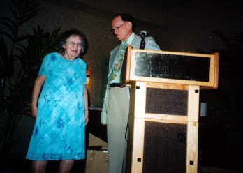 Dorothy Whitcomb is welcomed to the stage by Howard Weems