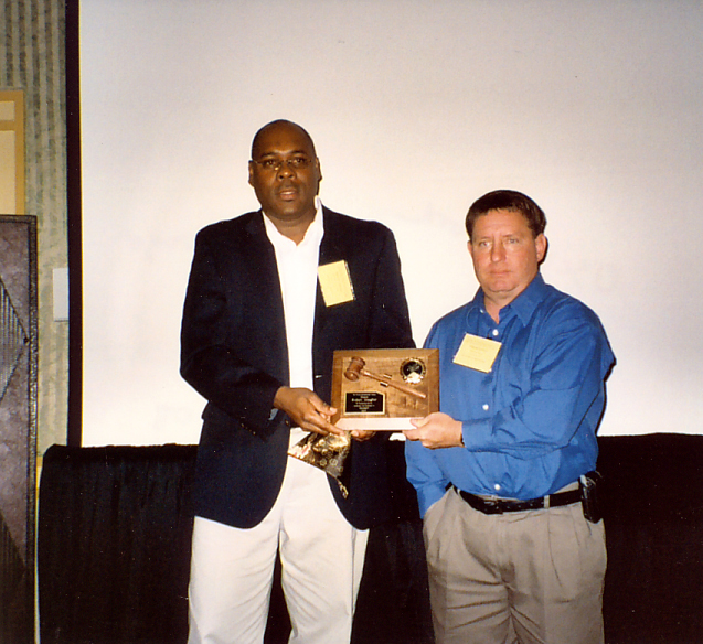 Rob Meagher receives Past President Award from Oscar Liburd